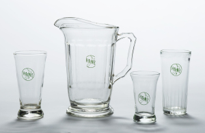 Glassware, mid-1960s, by Crown Crystal Glass, New Zealand (GH021024-25, GH023164, GH024221, Te Papa) Standardised glassware was introduced by the Hotel Association of New Zealand (HANZ) in 1963.  The 8 ounce glass on the far right was favoured by male drinkers.  The smaller 7 ounce glass on the left and the small sherry glass were favoured by women drinkers.  Jugs were considered an innovation in the early 1960s.