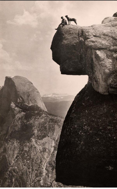 A man and his dog on the Overhanging Rock in Yosemite National Park,1924