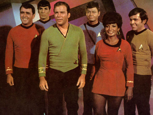 A variety of Star Trek uniforms